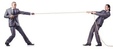 Mens in touwtrekwedstrijdconcept Royalty-vrije Stock Afbeelding