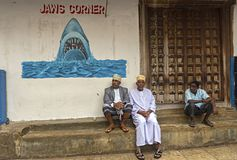 Mens trades on the street outside of Jaws corner in Stone Town, royalty free stock image