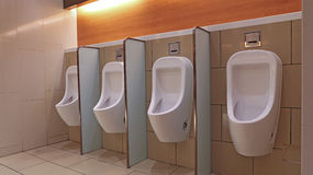 Mens urinals Stock Images