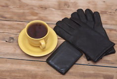 Mens wallet, gloves and coffee cup Royalty Free Stock Photography