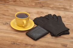 Mens wallet, gloves and coffee cup Stock Photo