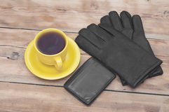 Mens wallet, gloves and coffee cup Royalty Free Stock Photos
