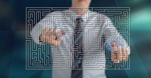 Mens wat betreft een labyrintconcept royalty-vrije stock afbeelding