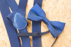 Mens wedding accessory, blue bow tie. On wood background royalty free stock images