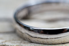Mens Wedding Ring on Wooden Deck Royalty Free Stock Photo