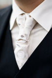 Mens wedding tie. Grooms torso with white tie and black shirt stock photography