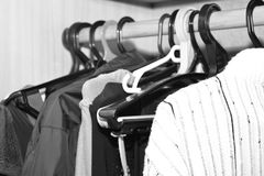 Mens and womans clothing on handers. Stock Image
