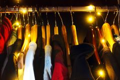 Mens, womens hipster wardrobe, with light bulbs stock photography