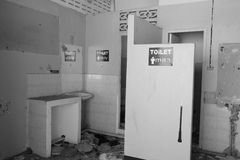 Toilets. A mens and womens toilet in an abandoned building in Bangkok, Thailand royalty free stock image