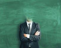 Mens zonder hoofd op bordachtergrond royalty-vrije stock afbeelding