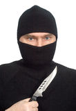 Mens in zwarte kleren met een mes. Royalty-vrije Stock Foto's