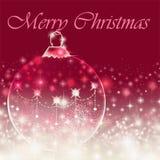 Mensagem do Feliz Natal no fundo vermelho com quinquilharia Fotografia de Stock