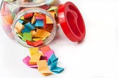 Mensagens coloridas em um frasco de vidro Fotografia de Stock Royalty Free