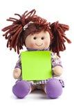 Mensaje de Copyspace del post-it del espacio en blanco de la tela de la muñeca de trapo Foto de archivo libre de regalías