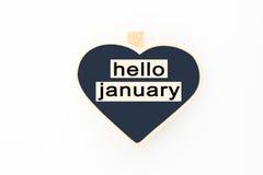 Mensaje de enero del concepto hola en los tableros de madera Imágenes de archivo libres de regalías