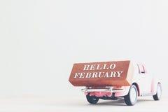Mensaje de febrero del concepto hola en el palillo Tono del vintage Imagenes de archivo