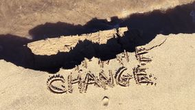 Mensaje de la arena de la cámara lenta del daño del cambio de clima