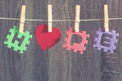 Mensaje de la ESPERANZA con el corazón rojo Foto de archivo libre de regalías