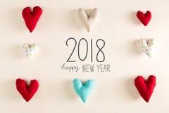 Mensaje 2018 de la Feliz Año Nuevo con los amortiguadores azules del corazón Foto de archivo