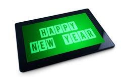 Mensaje de la Feliz Año Nuevo en la exhibición de tableta genérica Foto de archivo