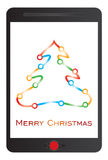 Mensaje de la Feliz Navidad en la tableta Imagen de archivo libre de regalías