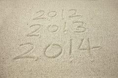 Mensaje del Año Nuevo en la arena Imagenes de archivo