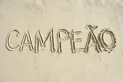 Mensaje del campeón de Campeao del brasileño manuscrito en arena Imagenes de archivo