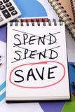 Mensaje del gasto y del ahorro Fotografía de archivo libre de regalías