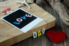 Mensaje del papá del amor en la foto inmediata en blanco Foto de archivo libre de regalías