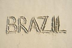 Mensaje manuscrito del Brasil en la arena lisa Foto de archivo