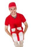 Mensajero que entrega un regalo decorativo Foto de archivo libre de regalías
