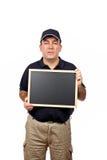 Mensajero que sostiene la pizarra vacía Foto de archivo libre de regalías