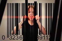 Mensch eingeschlossen im Verbraucher-Strichkode Stockbild