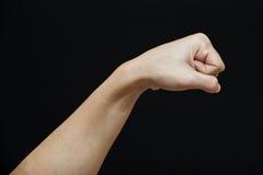 Menschliche Faust getrennt in einem schwarzen Hintergrund Stockfotos