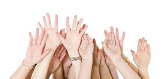 Menschliche Hände angehoben Lizenzfreies Stockbild
