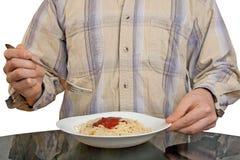Menschliche Hände mit Gabel und Isolationsschlauch Lizenzfreies Stockfoto