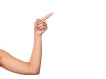 Menschliche Hand, die auf leeren leeren Kopienraum zeigt Lizenzfreie Stockfotografie