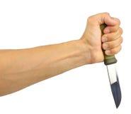 Menschliche Hand, die das Messer hält Stockbild