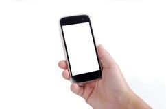 Menschliche Hand, die intelligentes Telefon lokalisiert auf weißem Hintergrund hält Stockfoto