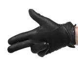 Menschliche Hand im schwarzen Lederhandschuh, der das Schießengestikulieren macht, Lizenzfreie Stockfotos