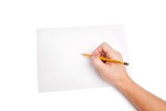 Menschliche Hand mit Bleistiftschreiben etwas Lizenzfreie Stockfotos