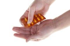 Menschliche Hand mit Tabletten Lizenzfreie Stockbilder