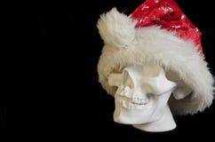 Menschlicher Schädel des weißen Gipses auf einem schwarzen Hintergrund in Santa Cla Lizenzfreies Stockfoto