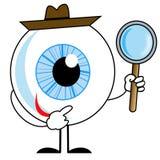 Menschliches Auge im Hut mit Lupe in den Händen Lizenzfreies Stockbild