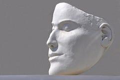 Menselijk gezicht dat in wit pleister gestalte wordt gegeven Stock Foto's