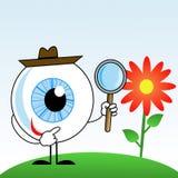 Menselijk oog in hoed met vergrootglas in handen Stock Foto's