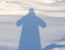 Menselijke schaduw op de sneeuw Royalty-vrije Stock Fotografie