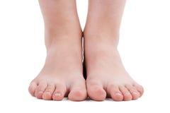 Menselijke voeten op een witte achtergrond royalty-vrije stock fotografie