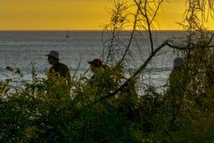 Mensen bij Strand in Zonsondergangtijd, de Galapagos, Ecuador Royalty-vrije Stock Fotografie