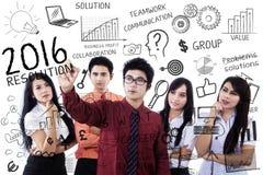 Mensen die een plan voor bedrijfsresolutie 2016 maken Stock Afbeelding